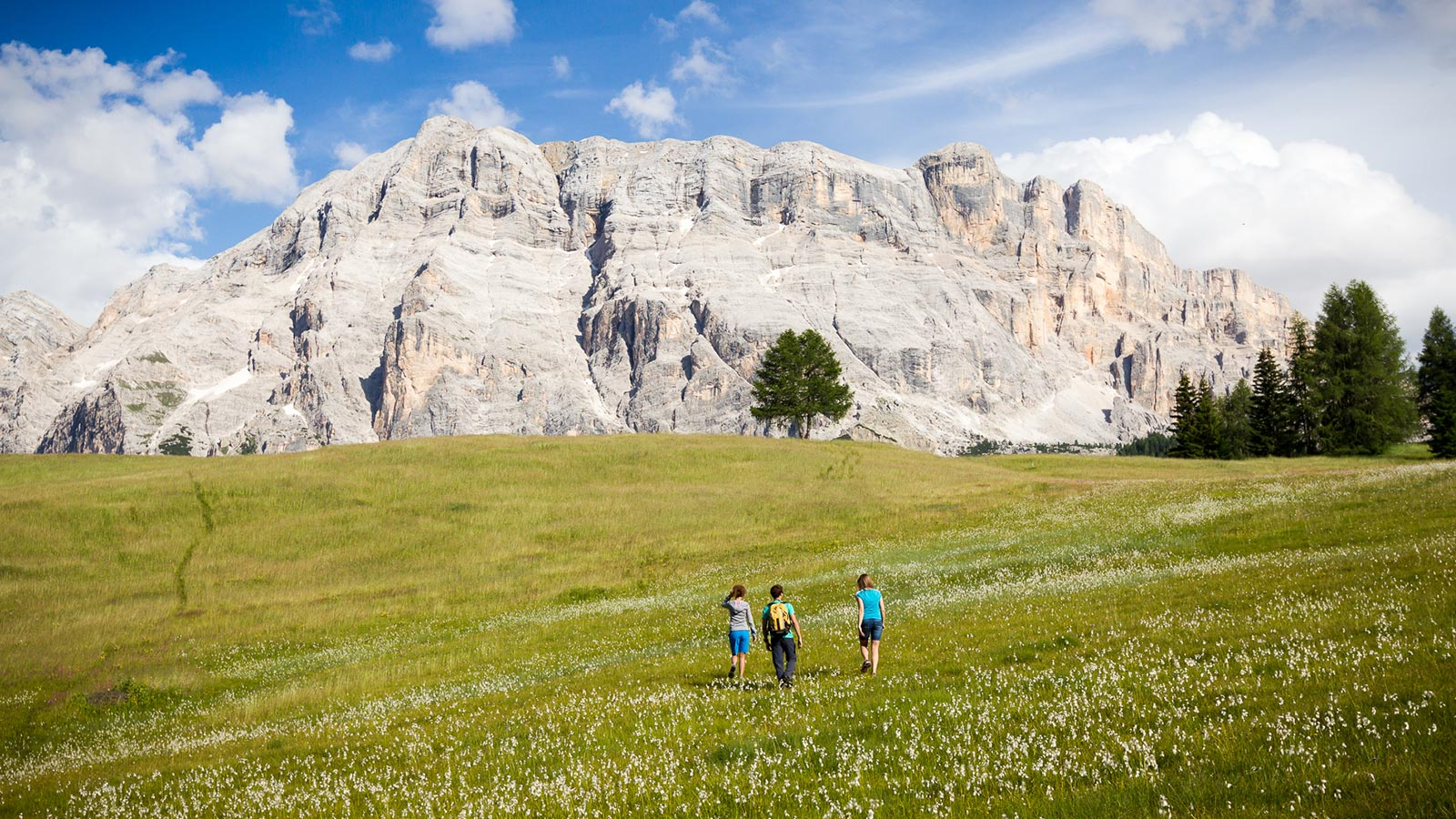 A family on a hike around Hotel Monte Cherz in Passo Campolongo